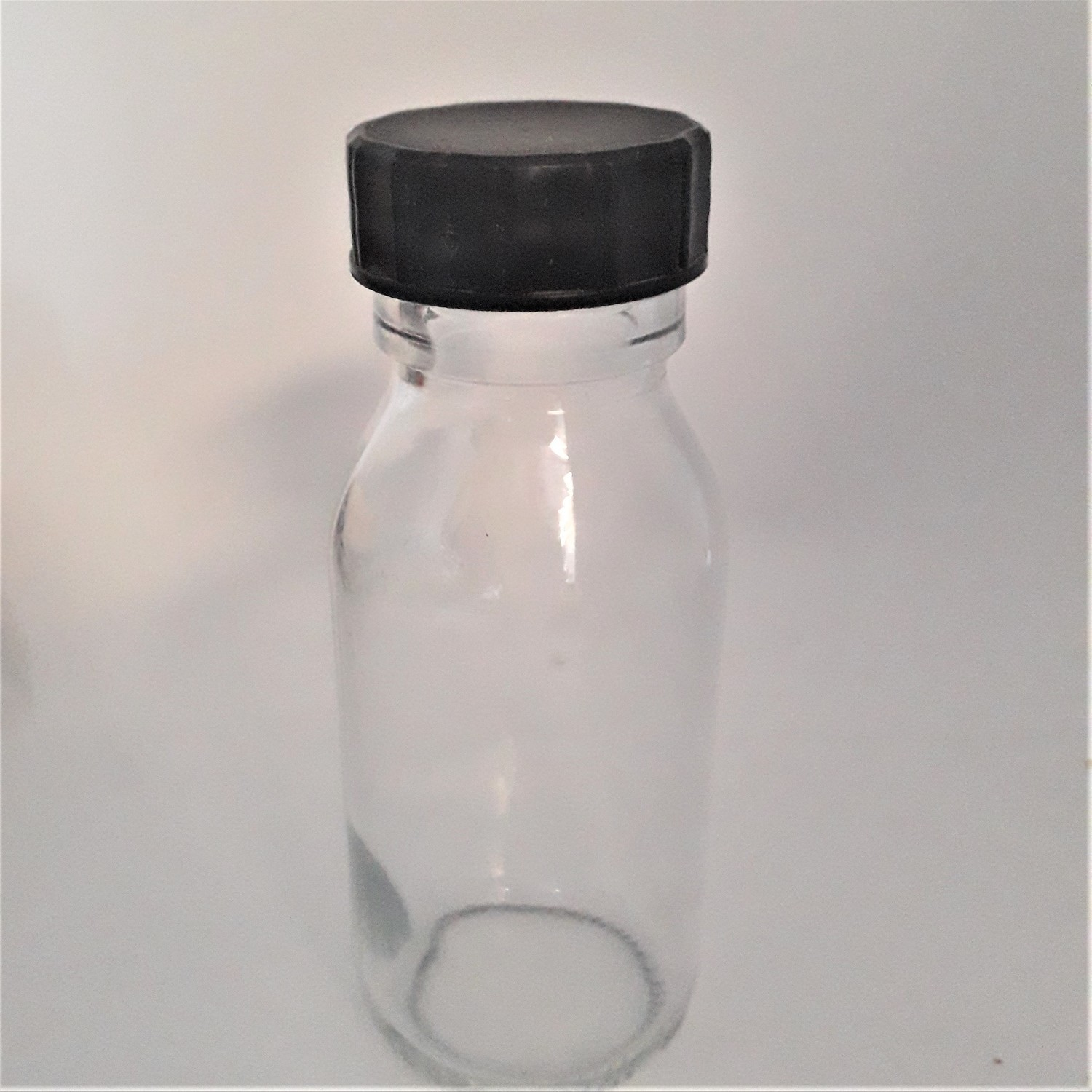 2oz 60ml Alpha Round Bottle with Cap