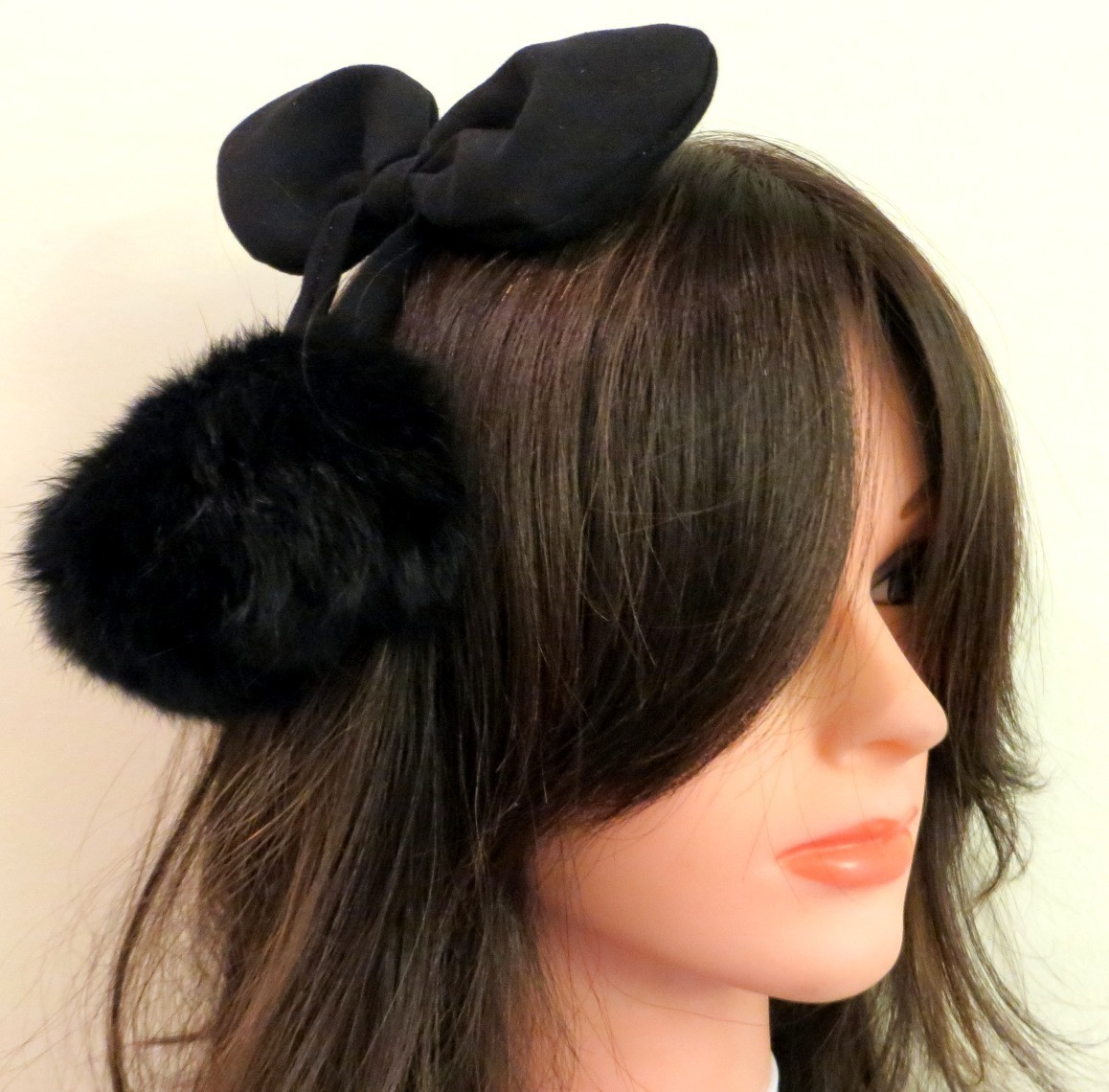 Black bow headband with dangling pom poms