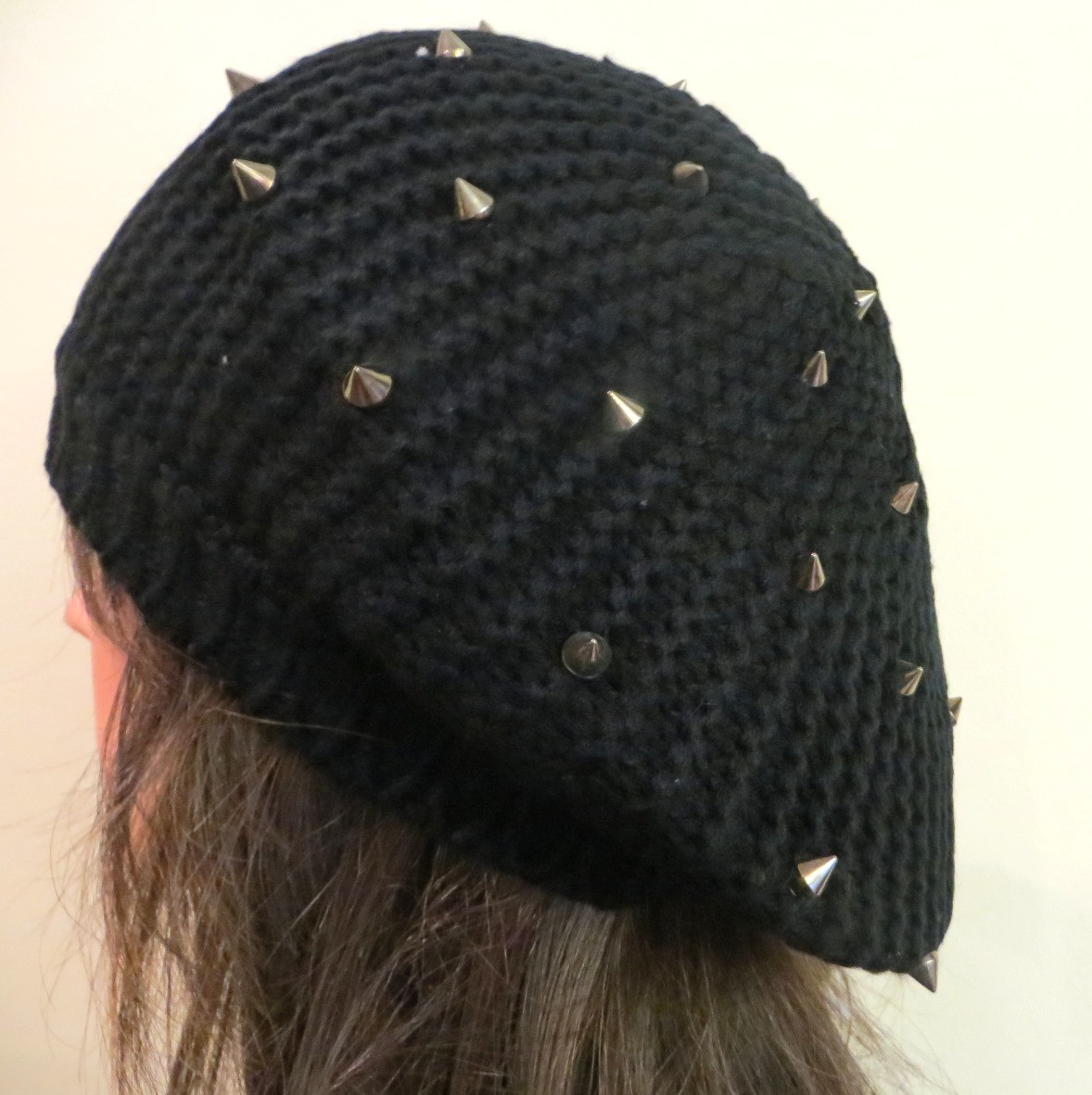 Black beret with spikes