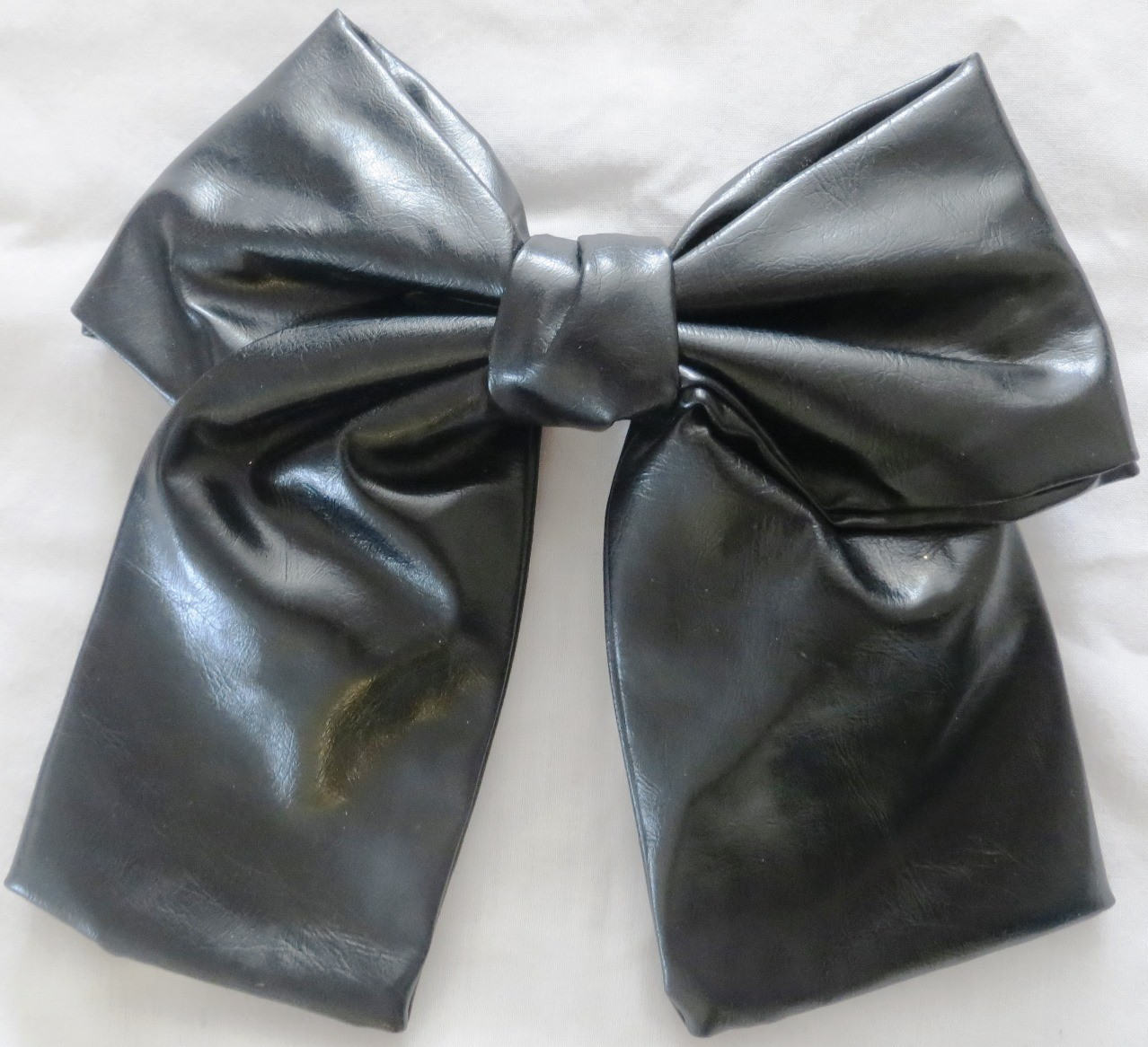 Black large faux leather bow