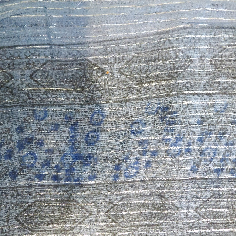 Dull light blue lurex tichel with blue berry flowers