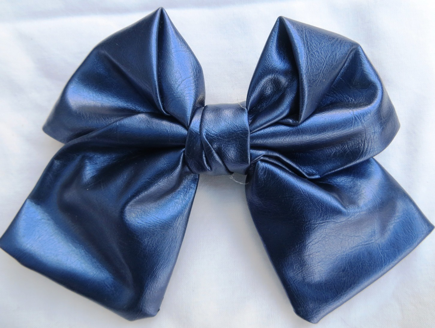 Blue faux leather metallic look bow
