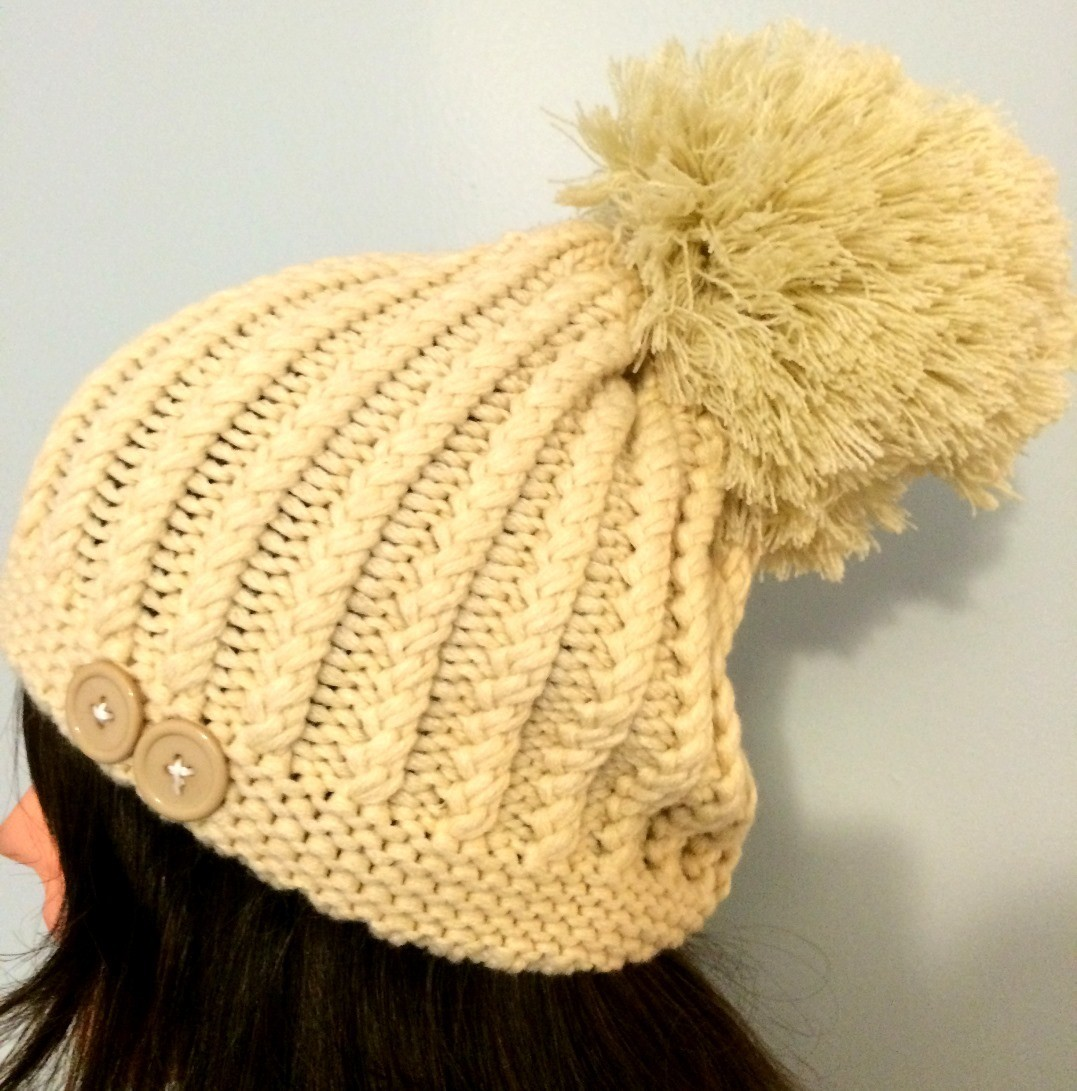 Off white beret with extra large pom pom