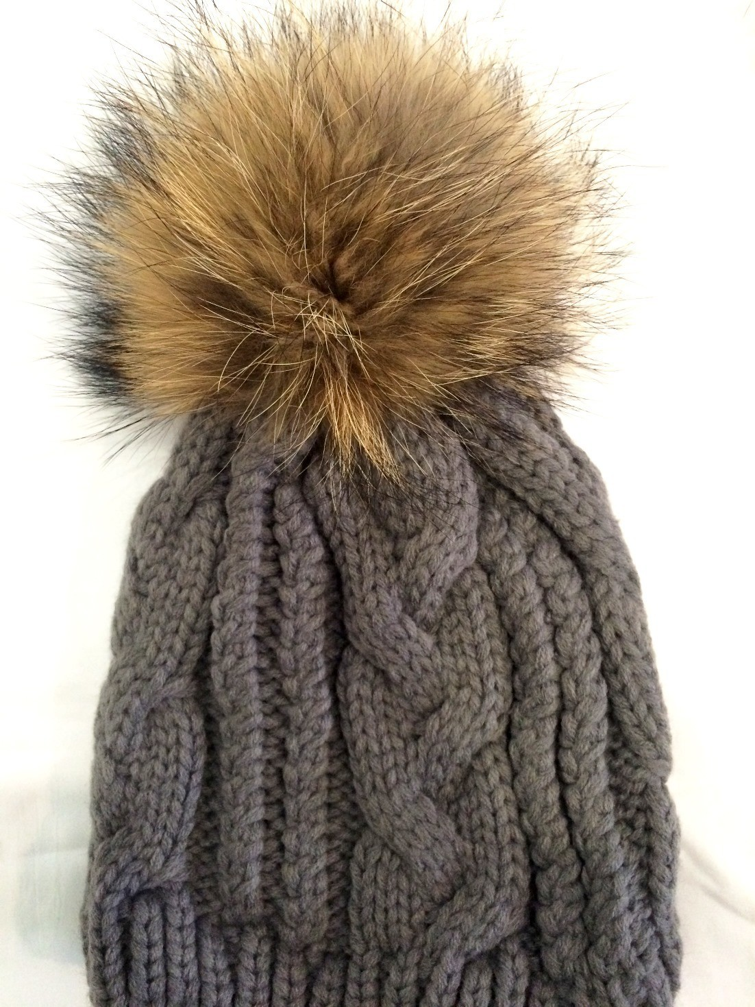 Gray cable knit fur pom pom hat