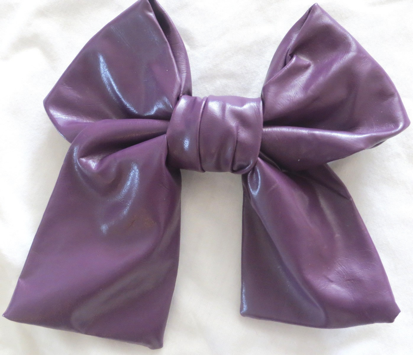 Purple large faux leather bow