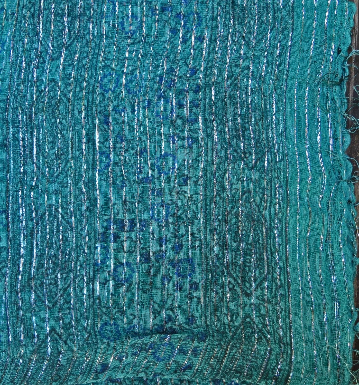 Medium sea green lurex tichel with blue berry flowers