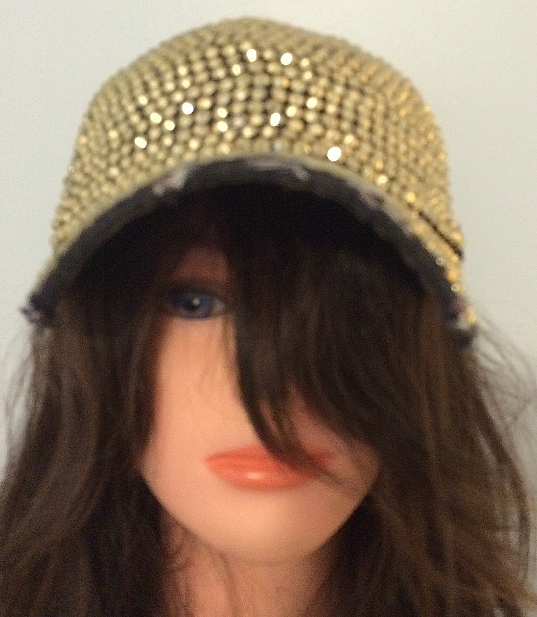 Black with gold bejeweled cap
