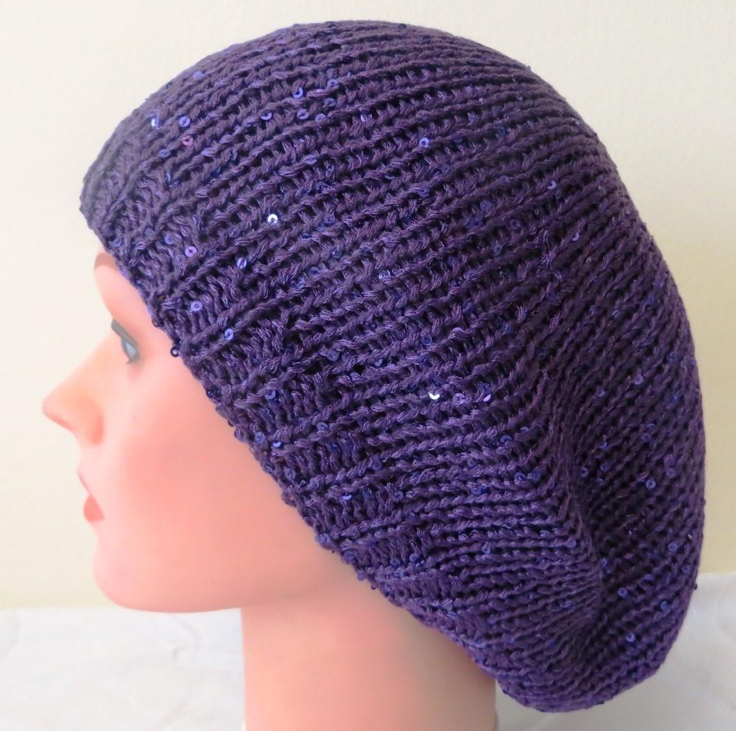 Purple beret with light sparkles
