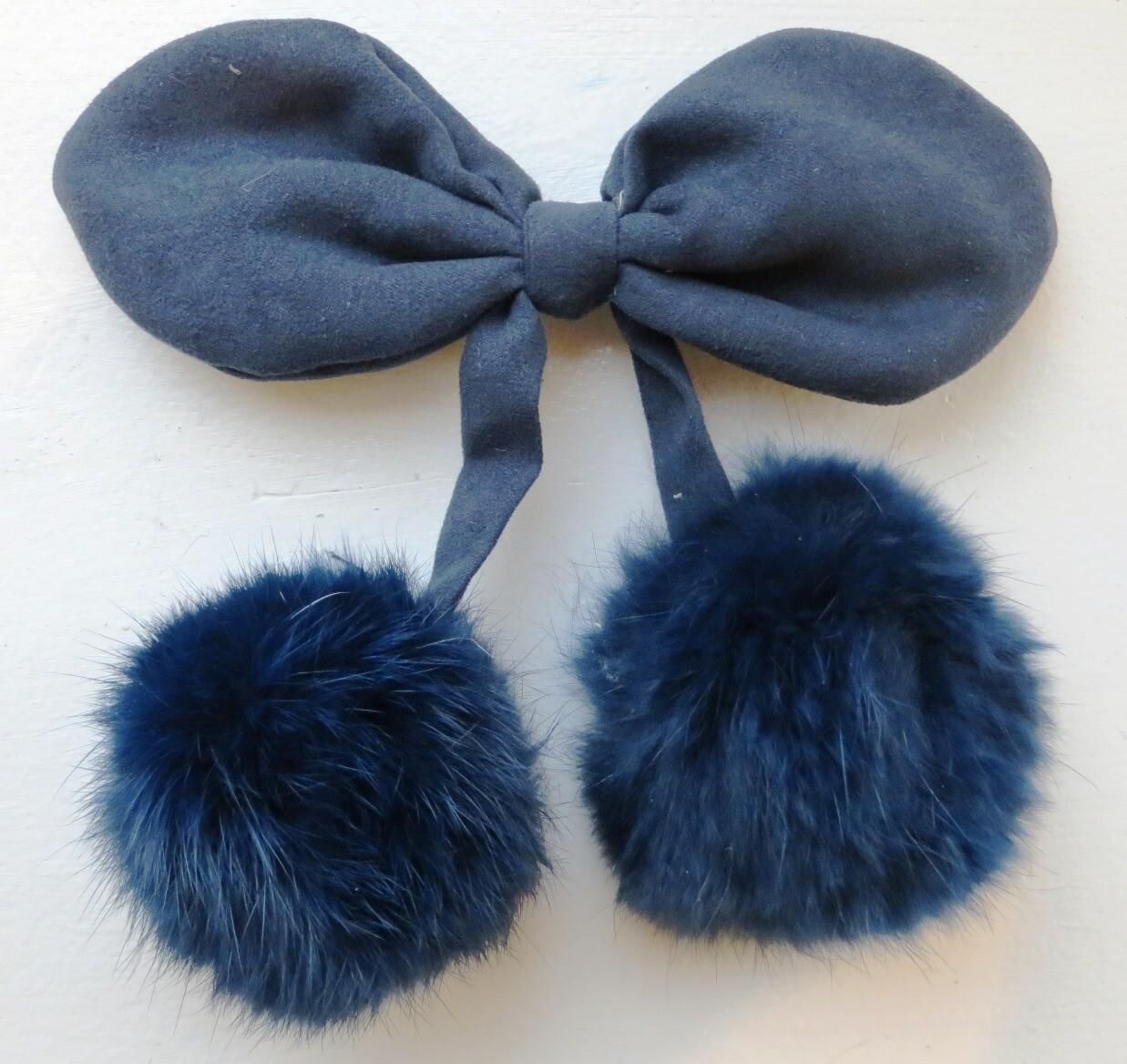 Blue bow clip with pom poms