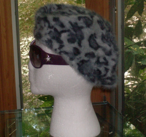 Leopard print beret gray background