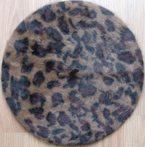 Leopard print beret beige background
