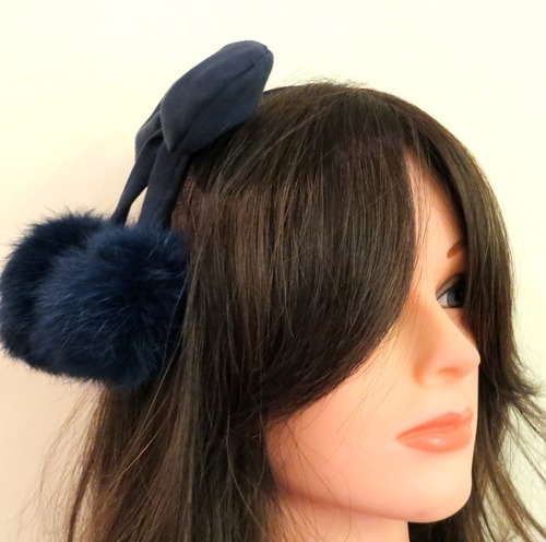 Blue bow headband with dangling pom poms