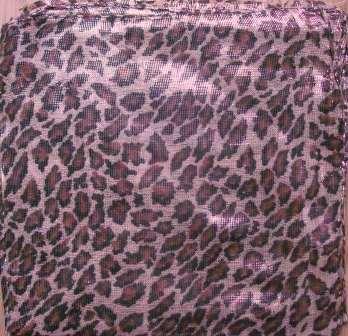 Leopard spots shimmering animal print tichel beige background
