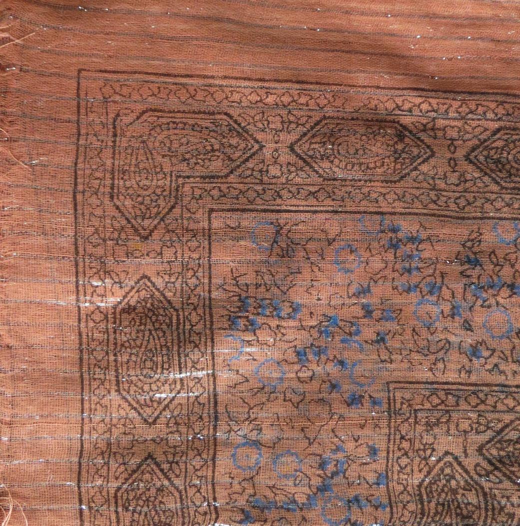 Burnt orange lurex tichel with blue berry flowers