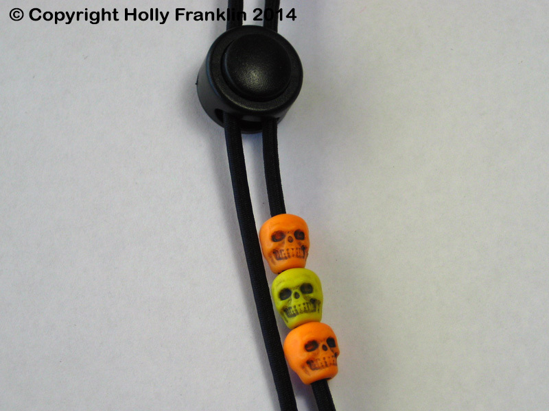 Black : Black - Orange and Yellow Skulls 1-UP_black-orangeyellowskulls