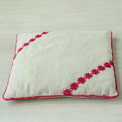 Therapeutic pillow with a cherry pit