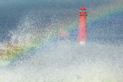 Art Photograph of a Rainbow appearing at Grand Haven, Michigan's Lighthouse and Pier.