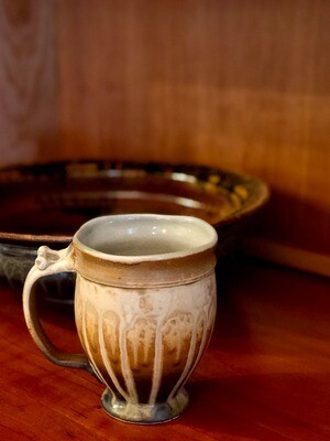 Footed ceramic mug