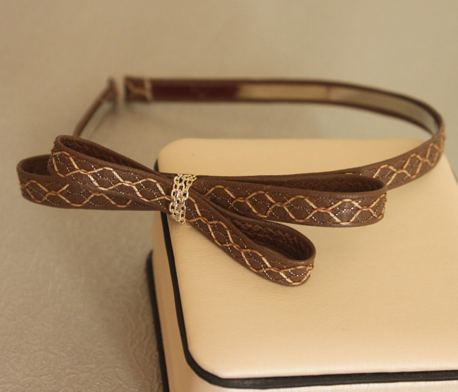 Faux leather bow-tie headband