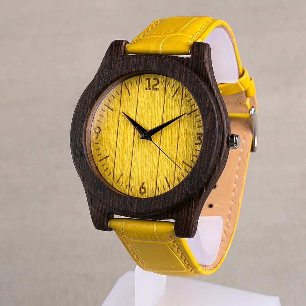 Деревянные дизайнерские часы из массива венге. Размер 45 мм. Циферблат - желтый шпон из кото. Ремешок из настоящей кожи желтого цвета. Персональная гравировка. Подарочная упаковка. Гравировка TW-WengeYellow