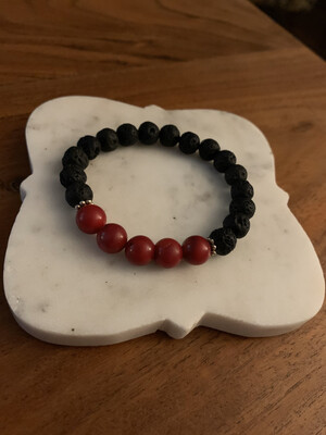 Lava stone and red beaded bracelet