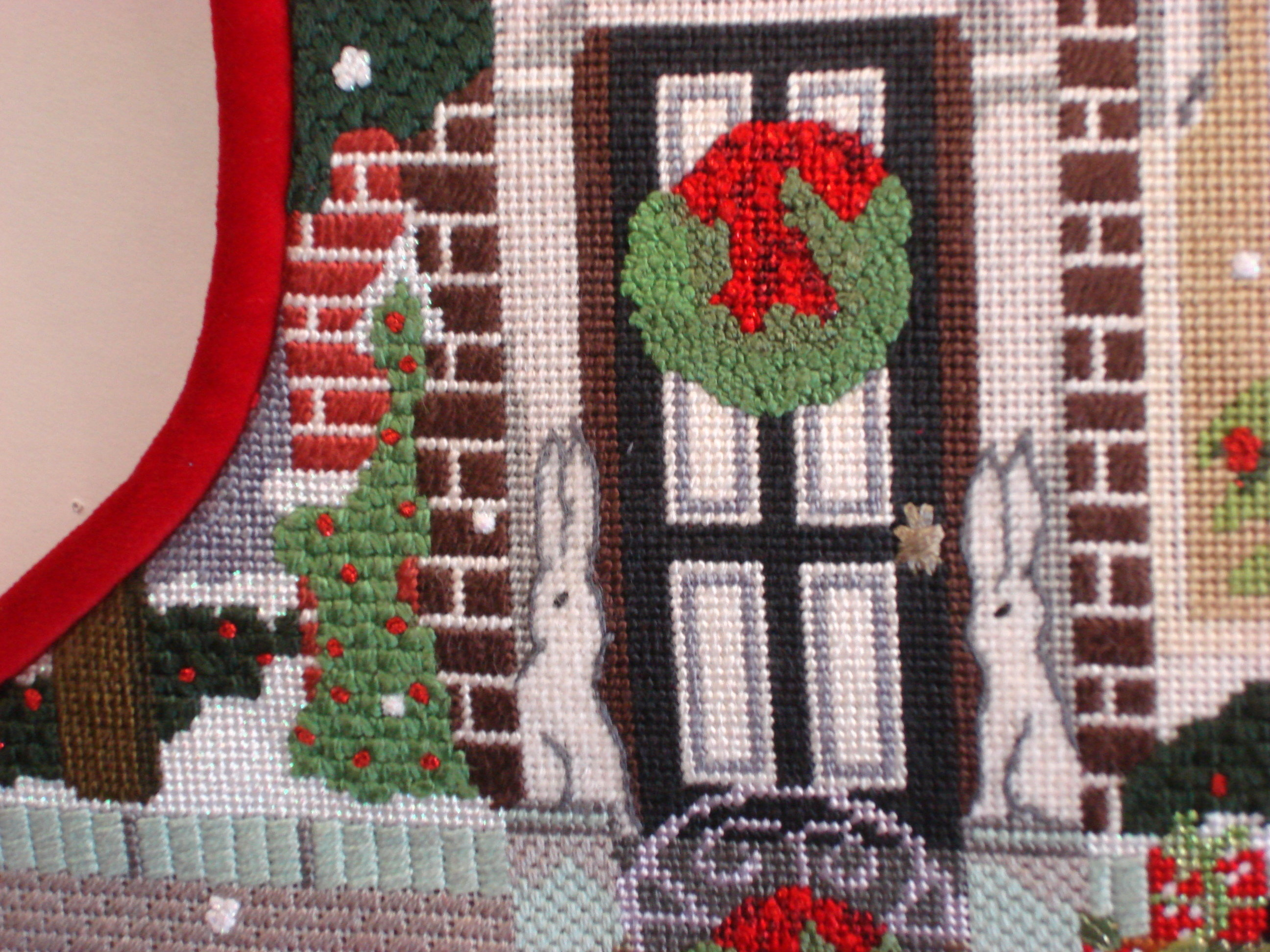 Christmas Townhouse Sock, model shown  (hand painted by Mary Lake Thompson)