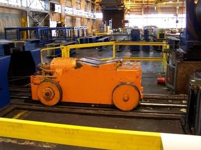 ​1 - USED 50,000 LB. AUTOMATIC FEED COIL CAR WITH PARKING STAND