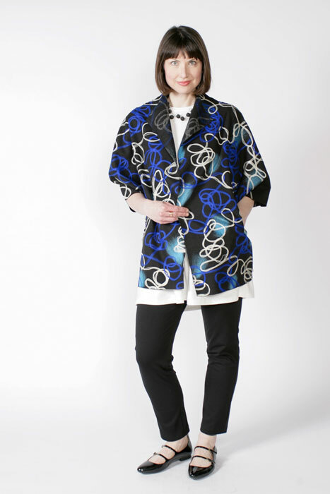 Chateau coat pattern made in blue and white wool swirl material