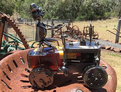 Nuts & Bolts - Tractor holds a Rum or Wine Bottle