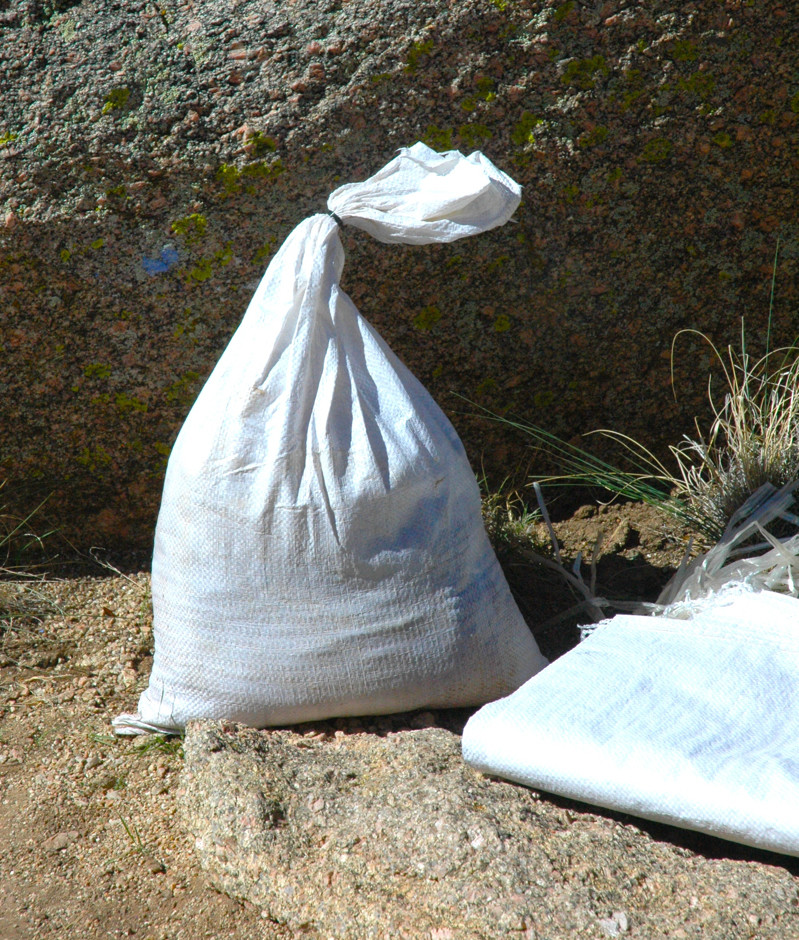 "White polypropylene sandbags, 14""x26"" - $0.65 ea."