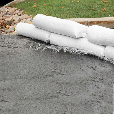 "Tube sandbags, filled - approx. 24""L x 8""W x 4""H, weight 50 lbs - starting at $4.00 each"