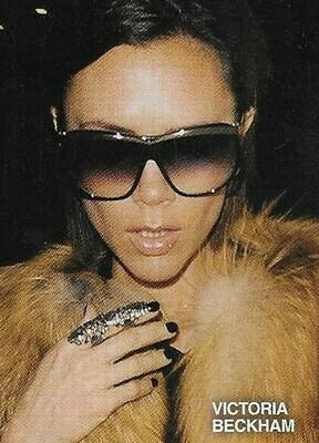 Beckham, Victoria / Sunglasses, Finger Ring, Fur   Magazine Photo   March 2010
