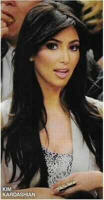 Kardashian, Kim / White Sleeveless Top, Gold Finger Ring   Magazine Photo   March 2010