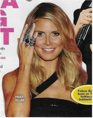 Klum, Heidi / Black Dress, Holding Up Ring   Magazine Photo   March 2010