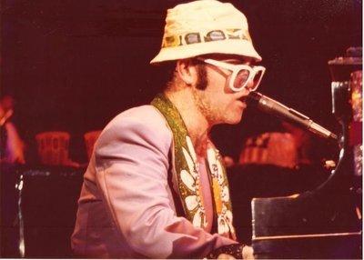 John, Elton / At Piano, Profile, White Glasses, Hat, Mostly Purple Jacket | Photo Print (1976)