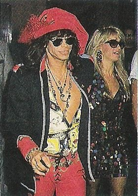 Aerosmith / Steven Tyler with Wife Teresa, Steven in Red Hat and Pants | Magazine Photo (1990)