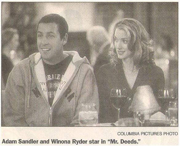 Sandler, Adam / Adam Sandler and Winona Ryder star in Mr. Deeds | Newspaper Photo with Caption | May 2002