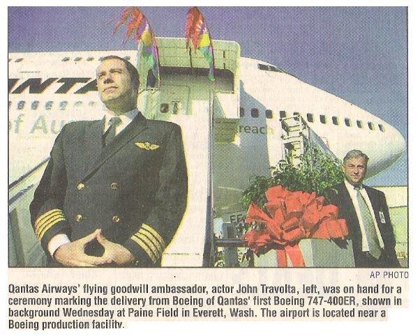 Travolta, John / Qantas Airways' Flying Goodwill Ambassador | Newspaper Photo with Caption | October 2002