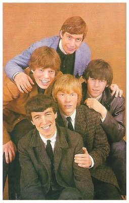 Rolling Stones, The / All 5 - Mick in Brown Jacket - Light Brown Background | Magazine Photo | 1960s