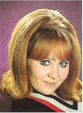 Lulu / Closeup - Purple Background - V-Neck Top | Magazine Photo | 1960s
