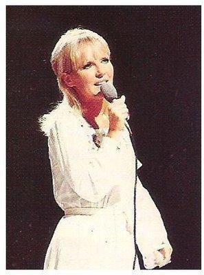 Clark, Petula / On Stage - White Outfit - Holding Mic. | Magazine Photo | 1960s