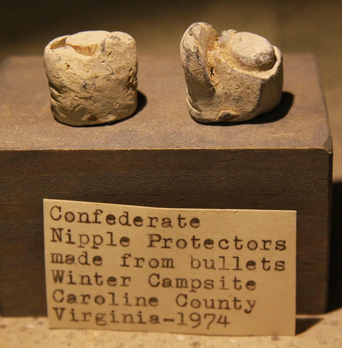 JUST ADDED ON 6/25 - CONFEDERATE WINTER CAMP CAROLINE COUNTY, VA - Two Soldier Carved Musket Nipple Protectors with Original Collection Label - found in 1974