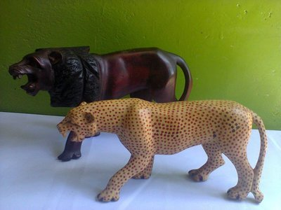Authnetic original Mara Simba Lion and Cheeter wooden sculptures from Kenya