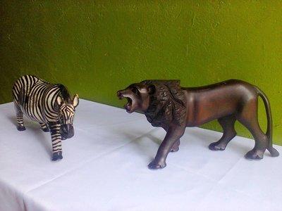 Authnetic original Mara Lion and Zebra  wooden sculptures made in Kenya