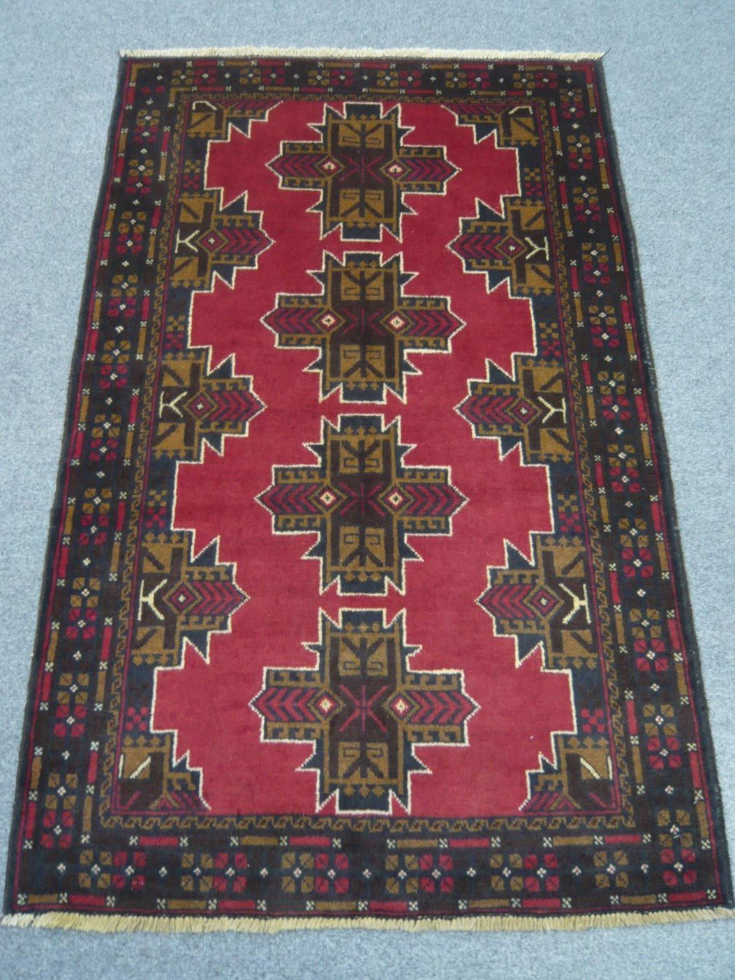 Afghan tribal rug sold 917406