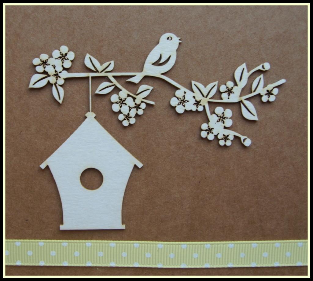 Birdhouse Hanging Below Blossom Branch
