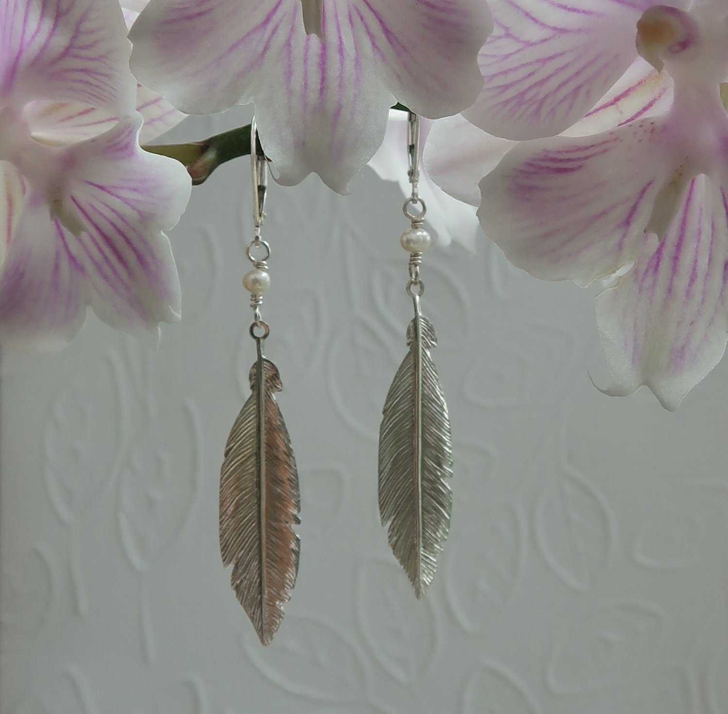 Sterling Feathers