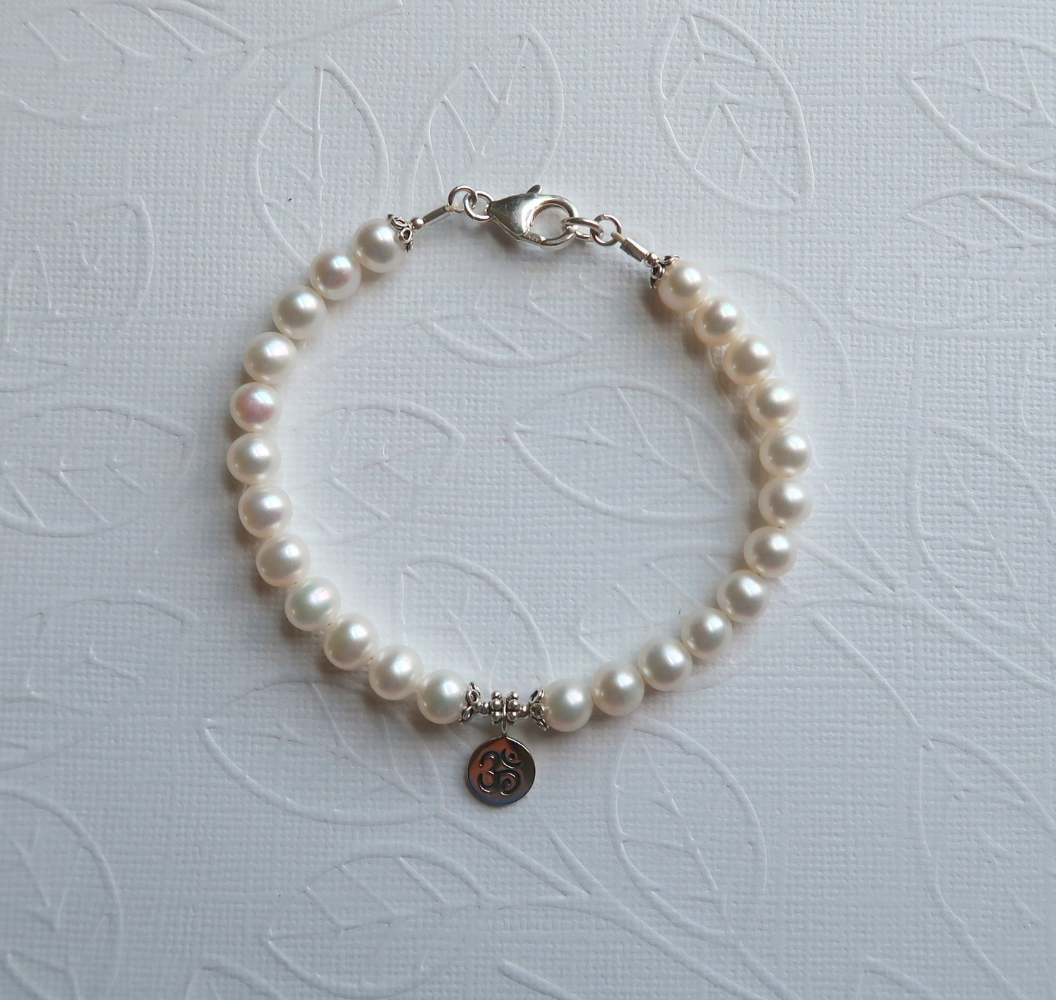 Cultured Pearl & Om
