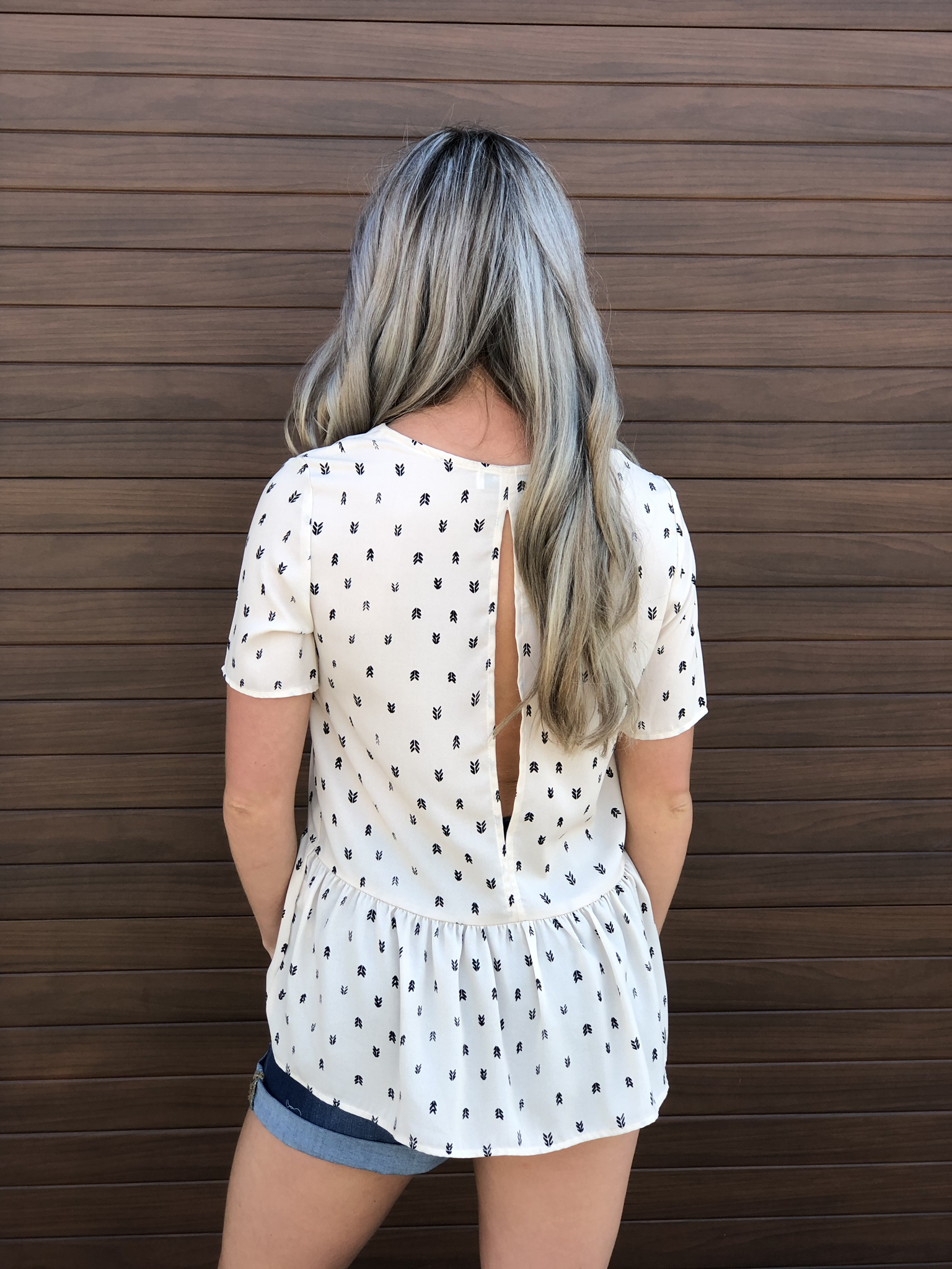 The Open Back Peplum Style Blouse