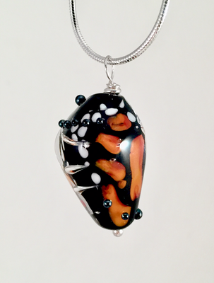 Monarch butterfly chrysalis pendant, late stage